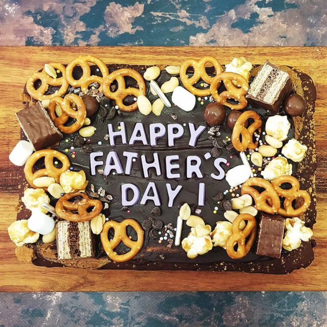 """FATHER'S DAY 2021 … It's father's day on Sunday 20 June and we have some super delicious treats to celebrate! … BROWNIE SLAB (Pictured) A whole slab of Belgian chocolate brownie topped with popcorn, peanuts, pretzels, tex, tumbles, mallows and chocolate chips. R180 … DOUGHNUTS! (See previous post) A box of four of our insane ring doughnuts, including the Biscoff, Crunchy Bar Snacks, Cinnamon Sugar and the ultimate """"dad doughnut"""", The HOMER. R100 … FATHER'S DAY TREAT BOX (See previous post) A box of goodies dad will LOVE! A salted caramel bar snack loaf cake, ***Bonanza brownies x 2, Peanut Butter Bomb Cookies x 2, Choc chip cookie dough cake pop x 1, Cinnamon Ring Doughnut x 1. R200 ... (***Bonanza brownies = Oreos baked into a brownie with a choc chip cookie base!) … Email hello@crumb.co.za to place your order ALL AVAILABLE IN VEGAN VERSIONS WITH SLIGHT ALTERATIONS - YAY! Collection from our studio in Woodstock on Sat 19/6 from 9 - 15pm & Sun 20/6 from 9 - 11am … #treatbox #fathersdaytreatbox #fathersday #brownies #doughnuts #cakepops #sweettreats #treats #dad"""