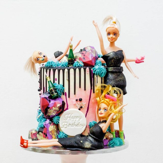 TRASHY, BUT CUTE 🍾🍾🍾 This crazy cake was to celebrate a best friend's 30th, from her besties.  I've never had a request for these trashy doll cakes, but they've suddenly started rolling in, and I'm trying to pull it off with some grace 😅 🍾🍾🍾 This one was our insane Biscoff cake layered with Biscoff buttercream, crushed biscuits and layers of Biscoff spread. It's the most delicious cake EVER!  🍾🍾🍾 The geometric hearts (@bakersboutiquestore) were stuffed with cake and tinted with my favourite - @colour.mill 🍾🍾🍾 #birthday #birthday🎂 #birthdaycakes #crumbcakes #crumb #celebrationcake #celebrationcakes #cakes #cakedecorator #dollcake #biscoffcake