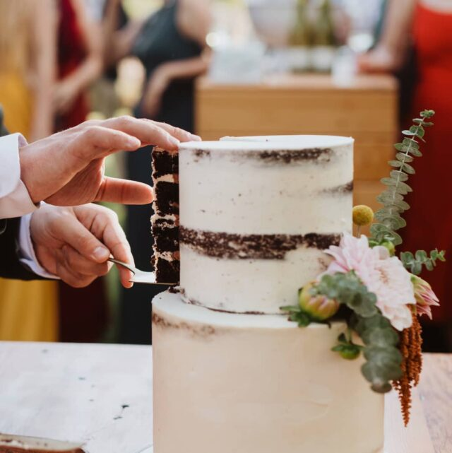 I love this image of our signature AMO  cake being cut - you can just see the delicious Belgian chocolate filling peeking through as the slice is being lifted out. So pretty and perfect in a simple but yet elegant way 💘💘💘 #weddingcakesofinstagram #weddingcakes #weddingcakes #crumbcakes #cakedecorator #capetownbakeries #cakesofig #weddingcakebaker #cakeoftheday #cakestagram
