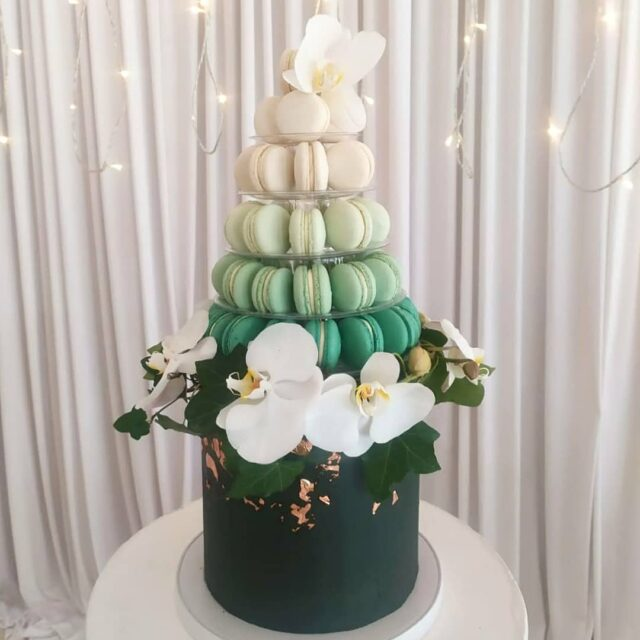 MAC STACK  🌿🌿🌿 How gorgeous is this macaron stack wedding cake? This is a bit of a pride post as this cake is the epitome of how far our vegan baking has come! 🌿🌿🌿 Yes - you read that right... The whole thing, even the macarons, are vegan. This means no eggs, no butter, no milk ... No animal derived products whatsoever, even down to the colours that are from @colour.mill. I'm very proud of it!  🌿🌿🌿 The cake is our super popular dark chocolate cake with @callebautchocolate buttercream and cocoa nibs, and the macarons are filled with vegan lemoncurd and raspberry jam 🌿🌿🌿 #vegan #veganbycrumb #crumb #crumbcakes #cakeme #crumbbyanmar #veganweddingcake #vegancapetown #veganmacarons #weddingcake #weddingcakes
