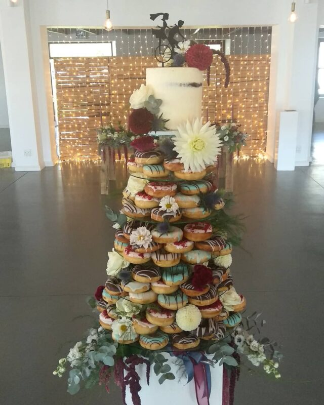 We teamed up with @thatdoughnutguyct to create this spectacular doughnut and wedding cake tower at @neo_eventvenue yesterday 😍 120 chocolate dipped doughnuts with a @cocoafair dark and milk chocolate cake at the top!  #weddingcake #cakes #crumbcakes #crumbcakessa #weddingcake #weddingcakebaker #weddings #wedding #doughnuts #donuts 🍰🍩